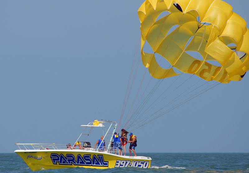 Come ride on our Bright Yellow parasail boat